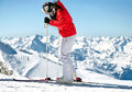 Female skier on ski slope in european alps Stock Photo