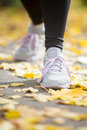 Female sneakers on the pave in a start position Royalty Free Stock Photo