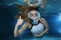 Female snorkeler happy show underwater hand signal Royalty Free Stock Photo