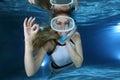 Female snorkeler happy show underwater hand signal Stock Photo