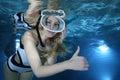 Female snorkeler happy show underwater hand signal Stock Photos
