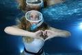 Female snorkeler happy show underwater heart signal Stock Photos