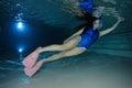 Female snorkeler with neoprene swimsuit underwater Royalty Free Stock Photo