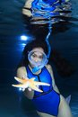 Female snorkeler and starfish underwater with Royalty Free Stock Photography