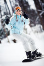 Female snowboarder showing thumbs up Stock Photography