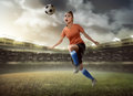 Female soccer player heading ball image of on the field Royalty Free Stock Image