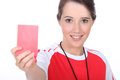 Female soccer referee holding out red card Royalty Free Stock Photo