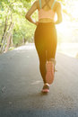 Female sport fitness runner jogging outdoors in spring or summer Royalty Free Stock Photo
