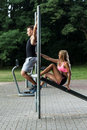Female sport instructor with her client in park Stock Photos