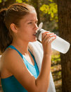 Female and Sport Water Bottle Stock Image