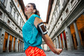 Female in sports outfit next to Uffizi gallery in Florence Royalty Free Stock Photo
