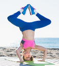 Female in sportswear exercising asanas of yoga