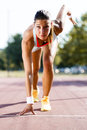 Female sprinter getting ready for the run beautiful during summer Stock Photography