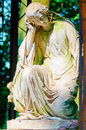 Female statue in dress of white marble Royalty Free Stock Photo