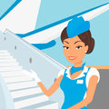 Female stewardess wearing blue suit and airplane behind Royalty Free Stock Photo