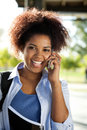 Female student answering mobilephone on campus happy young university Royalty Free Stock Photography