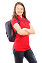 Female student with backpack looking at camera isolated on white background Royalty Free Stock Photography
