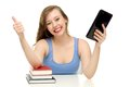 Female student with books and digital tablet Royalty Free Stock Photo