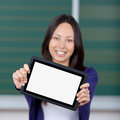 Female student displaying blank tablet pc smiling at university Royalty Free Stock Photo