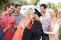 Female student and family celebrating graduation giving mother a hug Royalty Free Stock Image