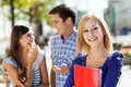 Female student with friends Royalty Free Stock Image