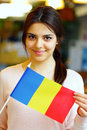 Female student holding flag of romania smiling Stock Photos