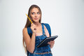 Female student holding pencil and notebook Royalty Free Stock Photo