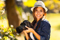 Female student photographer beautiful with her camera at the park Royalty Free Stock Images