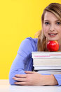 Female student posing with books Royalty Free Stock Image