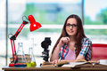 The female student preparing for chemistry exams Royalty Free Stock Photo