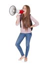 Female student shouting in megaphone young over white background Royalty Free Stock Images
