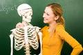 Female student with skeleton Royalty Free Stock Photo