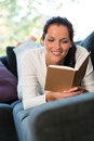 Female student studying couch home bookworm woman Stock Image