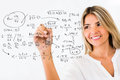Female student writing formulas Royalty Free Stock Photo