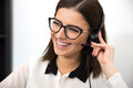 Female support operator in headset cheerful Stock Photography