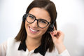 Female support operator in headset cheerful looking at camera Royalty Free Stock Image