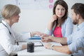 Female supportive gynecologist and young infertile couple Royalty Free Stock Photo