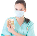 Female surgeon doctor holding money isolated on white background Stock Photography