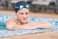 Female swimmer in blue water swimming pool. Sport woman. Royalty Free Stock Photo