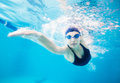 Female swimmer gushing through water in pool Royalty Free Stock Photo