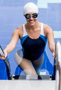Female swimmer in a pool beautiful looking very happy Royalty Free Stock Photo
