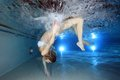 Female swimmer underwater in the pool Stock Image