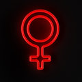 Female symbol in neon red Royalty Free Stock Photo