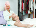 Female taking care of leg positive young skin after shower Royalty Free Stock Image