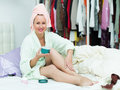 Female taking care of leg smiling skin after shower Royalty Free Stock Photos