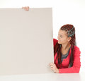 Female teenager with braids and blank board Stock Photo