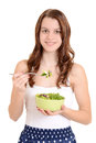 Female teenager eating salad Stock Photography