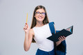 Female teenager holding book and pencil Royalty Free Stock Photo