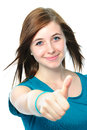 Female teenager shows a thumbs up on white background Royalty Free Stock Images