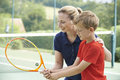 Female Tennis Coach Giving Lesson To Boy Royalty Free Stock Photo
